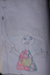 Dessin de Maëlle: c'est maman qui décroche les graines d'annatto de l'arbre.
